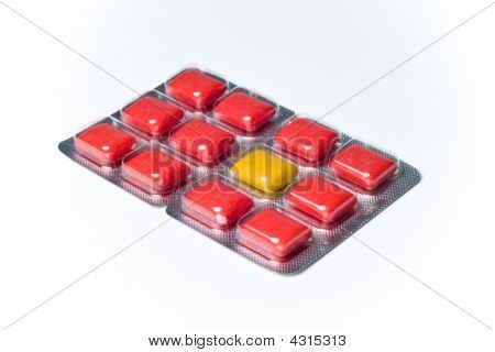 Oddball Different Yellow In Red Gum Blister Pack Concept On White Background