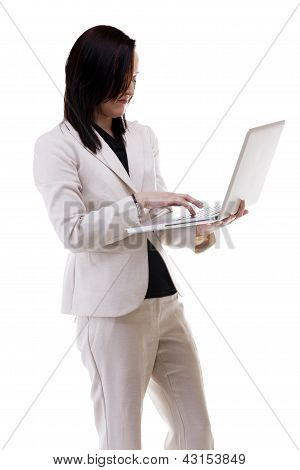 Young Businesswoman Working At A Laptop Isolated On White Background