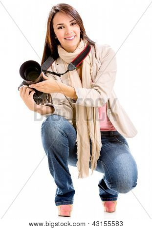Female photographer holding a digital camera - isolated over white