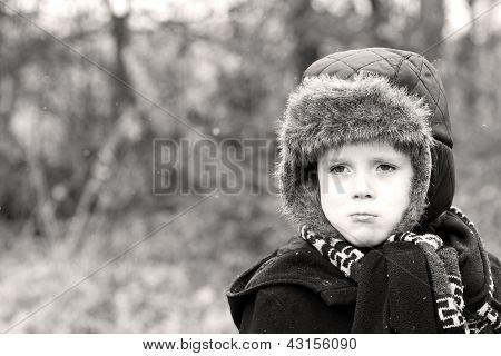 Grumpy Little Boy With Sad Bottom Lip