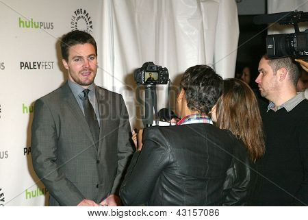 BEVERLY HILLS - MARCH 9: Stephen Amell in interviewed by the media at the 2013 Paleyfest