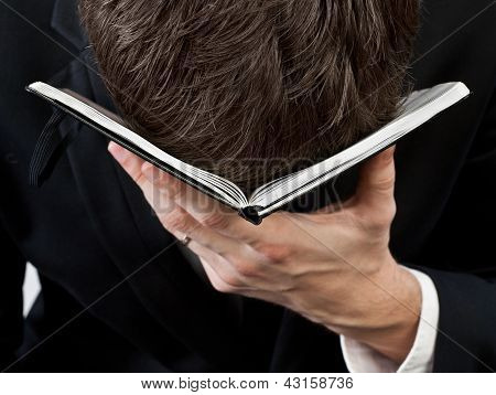 Man Head Omitted On Notebook