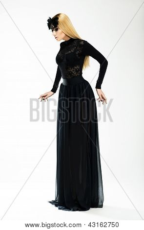 Nostalgia. Expression. Beautiful Blond In Long Retro Dress And Black Mask