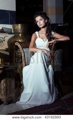 Wedding Style. Aristocratic Bride Sitting In White Dress. Restaurant Interior