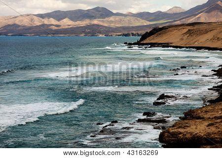 Surf on the rocky coast, Fuerteventura, Canary Islands, Spain