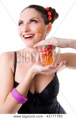 Happy Girl With A Glass And Sweets