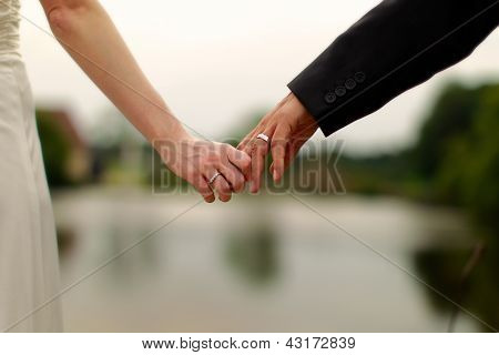 Newly Weds Holding Hands