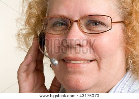 Mature Woman On Telephone Headset
