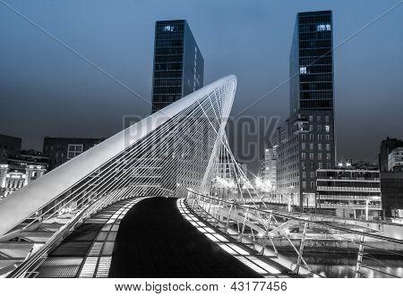 Nightview of Zubizuri bridge and Isozaki towers in Bilbao, Spain