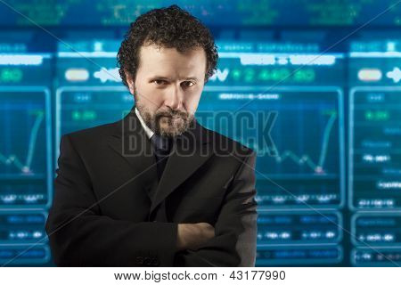 businessman with beard and black suit in the stockmarket