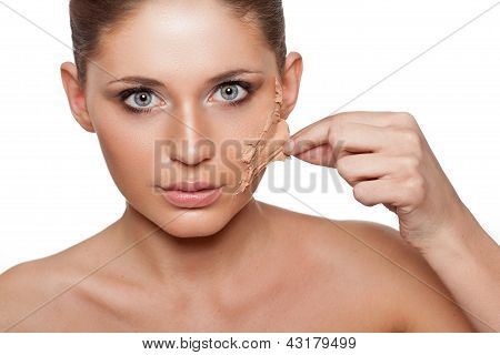 woman taking off her skin from face