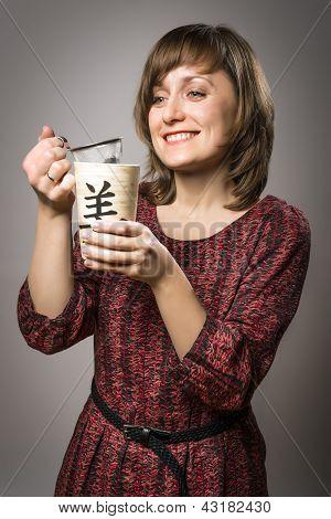 Woman Prepares Tea