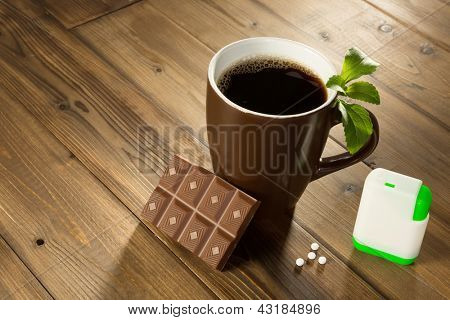 Cup of coffee with stevia sweetener tablets and Belgian chocolate without sugar