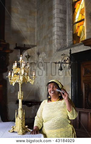 Religious hymns sung by a mature gospel singer in church