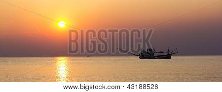Fisherman boat in the sunset scene