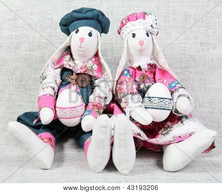Two Easter Bunnies Holding Eggs
