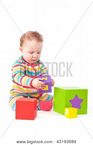 Cute Baby Playing Isolated On White.