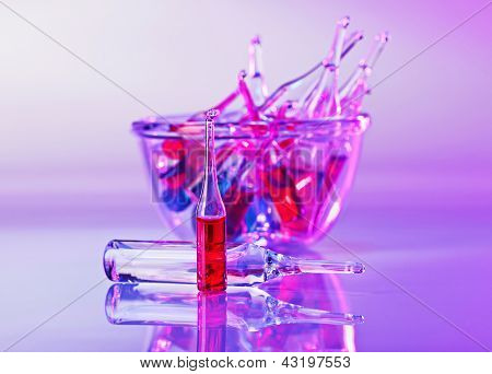 Medical ampoules still life in vivid violet colors