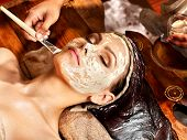 stock photo of sari  - Woman having facial mask at ayurveda spa - JPG