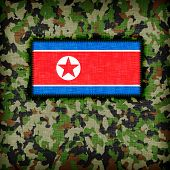 pic of ami  - Amy camouflage uniform with flag on it North Korea - JPG