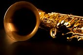 foto of sax  - Tenor sax golden saxophone macro with selective focus on black - JPG