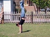 image of teen pony tail  - shot of an adolescent female playing in the yard - JPG