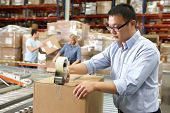 stock photo of dispatch  - Workers In Distribution Warehouse - JPG
