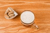 pic of stein  - High angle view of a beer stein and some peanuts - JPG