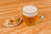 foto of stein  - Stein of beer served with a portion of pork rinds - JPG