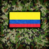 stock photo of ami  - Amy camouflage uniform with flag on it Colombia - JPG