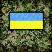 stock photo of ami  - Amy camouflage uniform with flag on it Ukraine - JPG