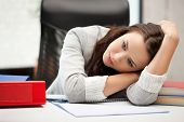 stock photo of clipboard  - bored and tired woman behid the table - JPG