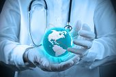 image of scrubs  - Medical Doctor holding a world gobe in her hands as medical network - JPG