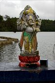 foto of brahma  - grey marble statue of a Hinduism elephant Shiva vishnu Brahma in a temple near a lake in mauritius africa - JPG