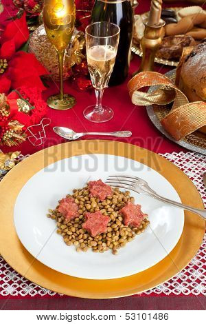 Pig Trotter Star Shaped With Lentils Over Christmas Table