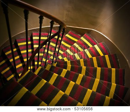 Footsteps With Carpet On Spiral Ladder In A Small French Hotel