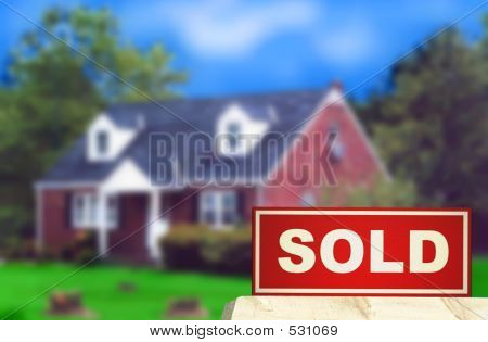 Real Estate Sold Sign and House