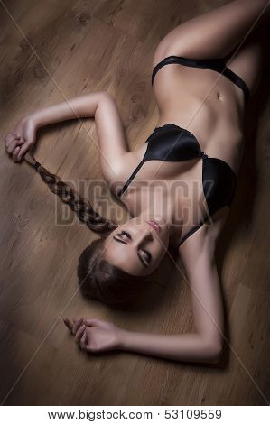 Attractive Girl On Timber Floor