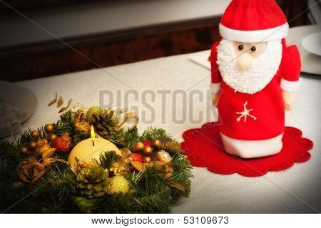 Christmas Centerpiece With Candle And Bottle As Santa Claus