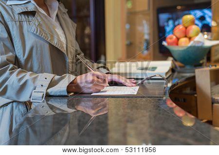 Guest Filling In Registration Form