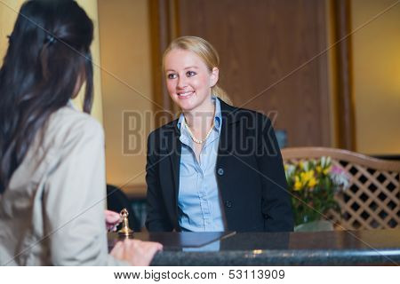 Beautiful blond hotel receptionist
