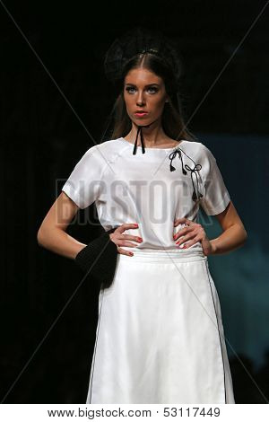 ZAGREB, CROATIA - OCTOBER 25: Fashion model wearing clothes designed by Borna and Fils on the Cro a Porter show on October 25, 2013 in Zagreb, Croatia.