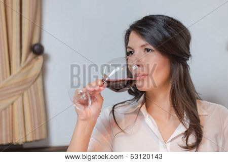 Attractive Woman Drinking Red Wine