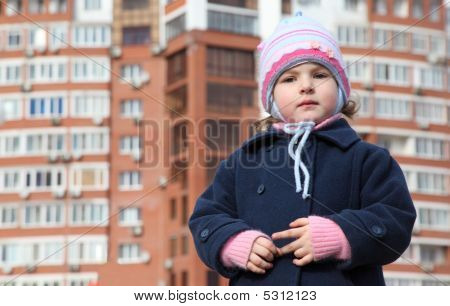 Little Girl Against New Building