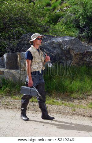 Fisherman Walking Down Path
