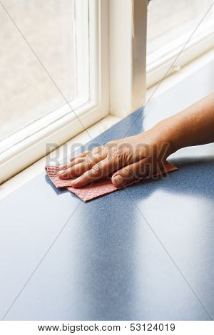 Hand With Dish Cloth Cleaning Surface
