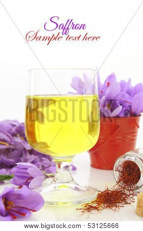 Glass off saffron tea and saffron flowers