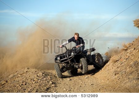 Teen Riding Quad Atv In Hills