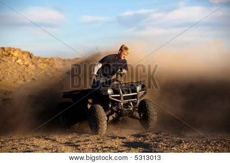 Riding Atv - Teen On Quad