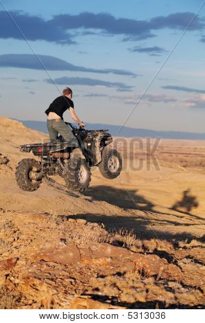 Teen Jumping On Quad Atv